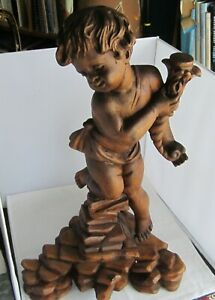 Carved cupid