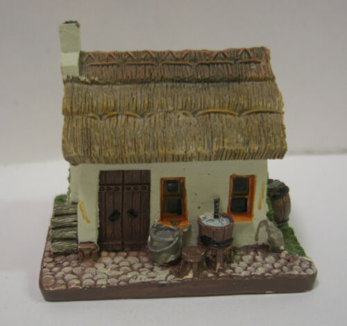 IRELAND IRISH COTTAGE WITH THATCH ROOF TIGEEN WITH MAN PLAYING ACCORDIAN
