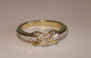 0f2d89524 Tiffany & Co 18k 750 yellow gold diamond signature X crossover ring ...