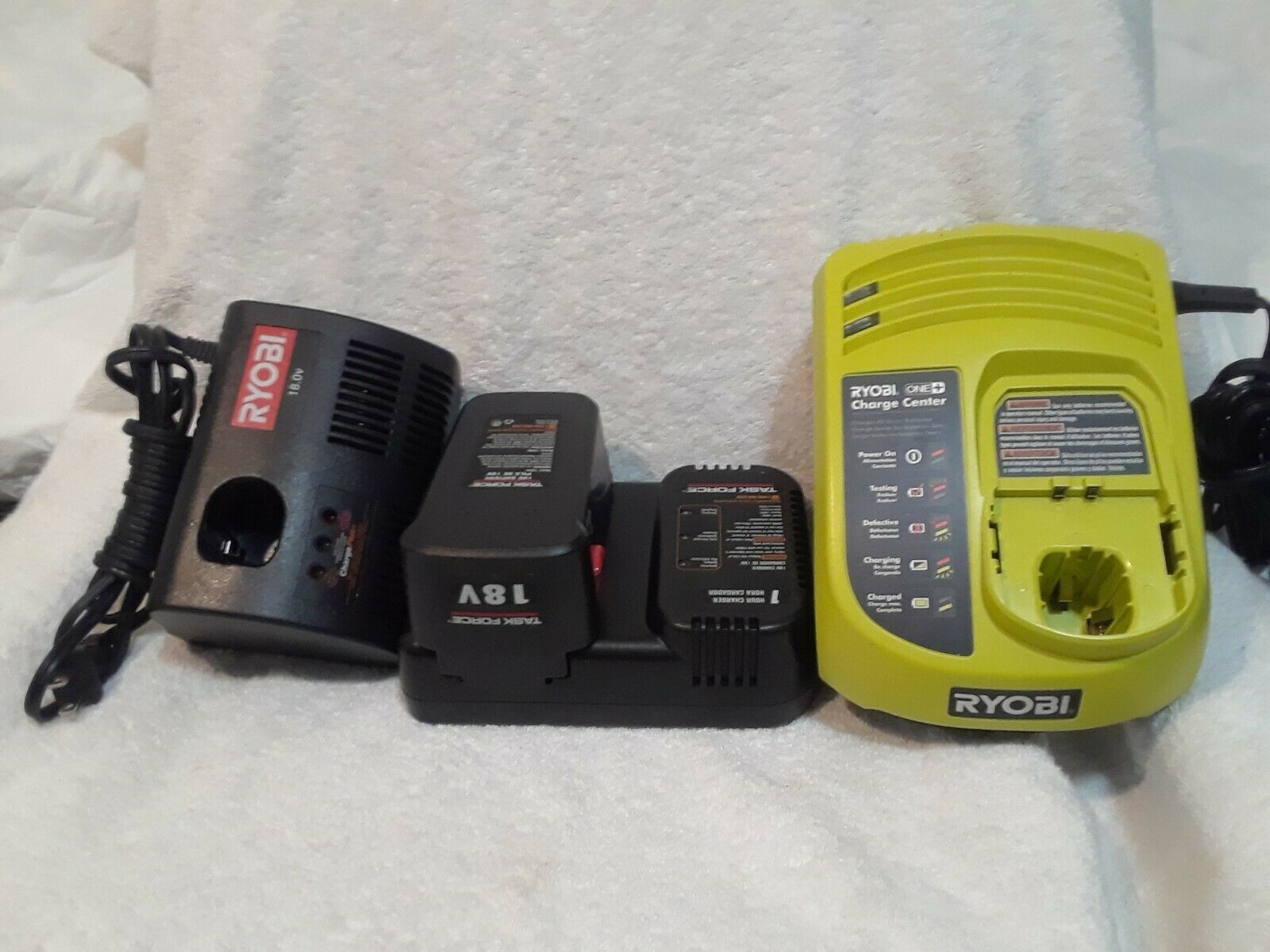 (3) DIFFERENT BATTERY CHARGERS PLUS (1) BATTERY