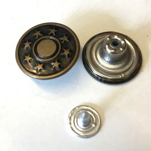 10 sets of aged bronze metal jean tacks with a star pattern