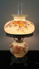 1967 Antique style brass base table lamp with glass chimney glass floral shade