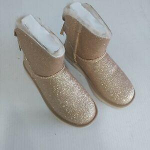 4ae9ca28c NIB UGG Women's Mini Bailey Bow Sparkle Sheepskin Boots Gold Size 7 ...
