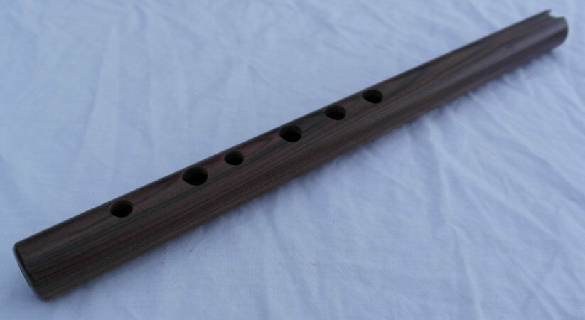 Wooden andean quena jacaranda flute with a decorated protective carry bag