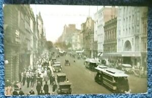 1920-039-s-postcard-The-Block-Collins-St-Cable-Trams-pedestrians-cars-Melbourne