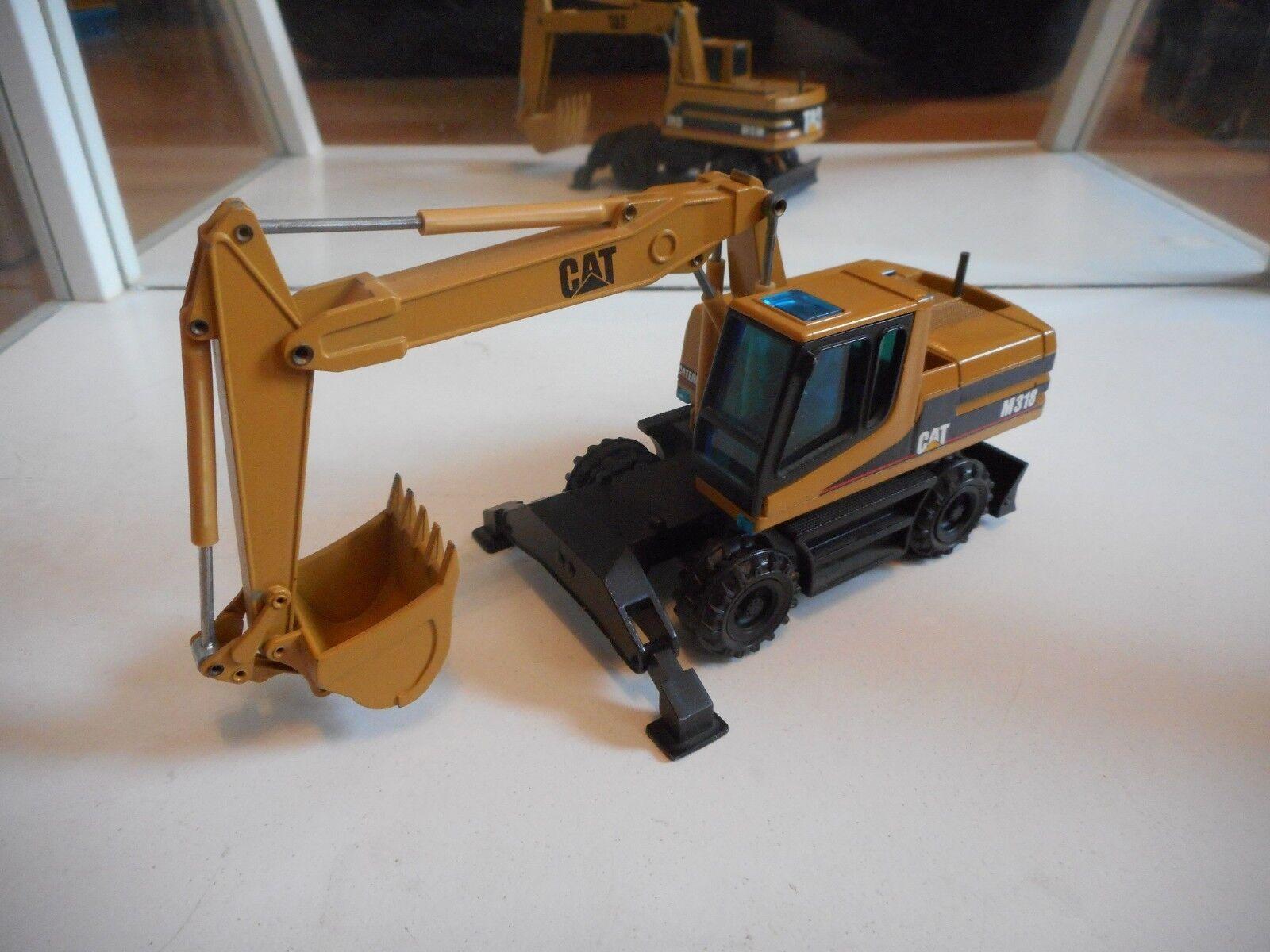 NZG Caterpillar Cat M318 Excavator in Dark yellow on 1 50