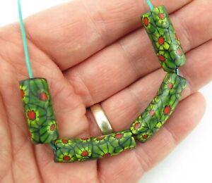 Four Venetian glass millefiori African trade beads (2 elbow)