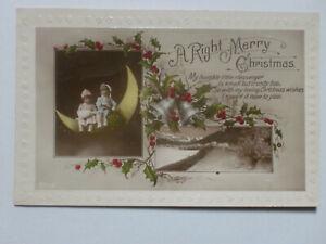 Merry-Christmas-Children-Kids-Sitting-on-Moon-Holly-Berries-RP-Postcard-1926
