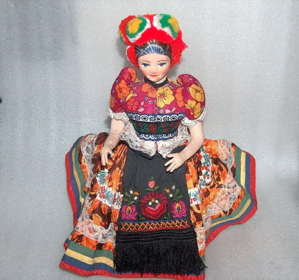 RARE VINTAGE NICE SITTING ON A CHAIR FOLK DOLL IN TRADITIONAL COSTUME, HUNGARY