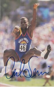 Carl Lewis, American Olympic track & field champion, won 8 medals. Signed card.