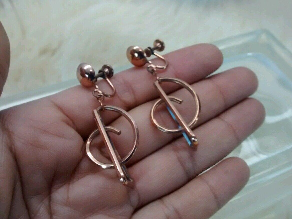 Pretty vintage mid century  Studio modernist copper 3 D screw on earrings