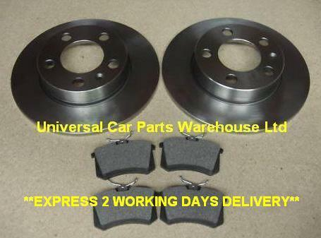 VW POLO T D TDI  02-TWO SOLID REAR BRAKE DISCS AND A SET OF BRAKE PADS LH /& RH