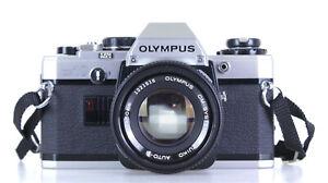 Olympus OM 10 Lens Olympus Zuiko 50mm F 1.8   (Réf#C-250)