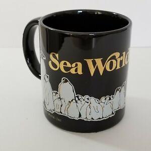 VINTAGE 1985 SEA WORLD PENGUINS & ORCA BLACK WITH GOLD COFFEE MUG