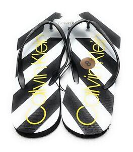 a93847d3a205 New Women s CALVIN KLEIN Black   White Flip Flops Slippers Sandals ...