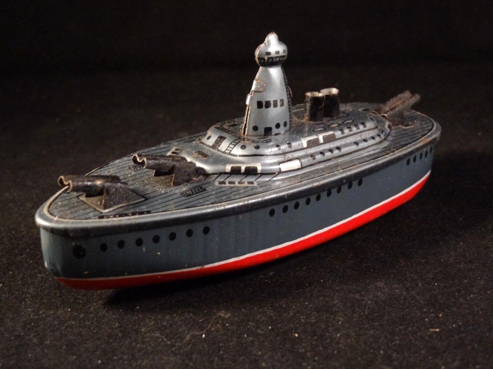 Ancien jouet bateau navire de guerre canon tôle lithographiée KK style penny toy