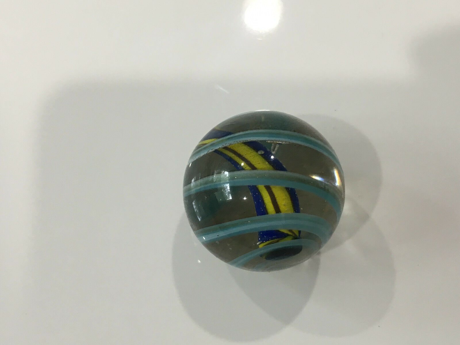 Unknown Age Blown Glass Shooter Marble Light bluee White Yellow Swirl