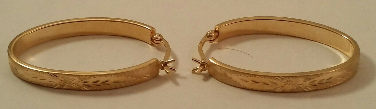 Elongated 14k gold Diamond Cut Hoop Earrings
