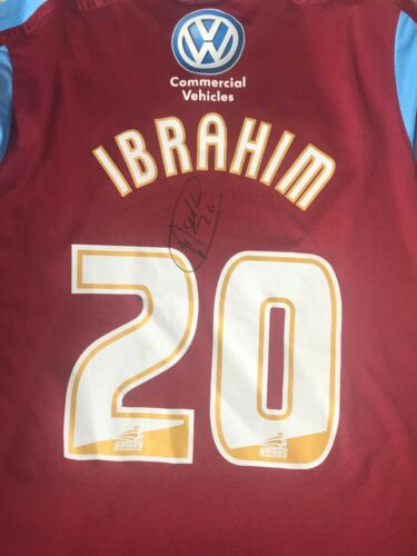 ABDISALAM IBRAHIM HAND SIGNED MATCH WORN SCUNTHORPE UNITED SHIRT VERY RARE.