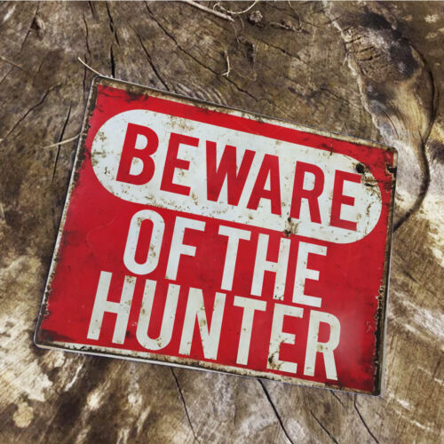 VINTAGE ENAMEL METAL TIN SIGN WALL PLAQUE Beware of the Hunter