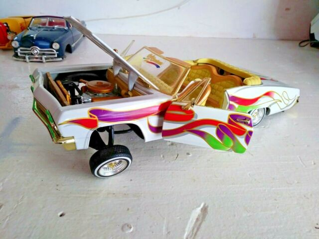 1:18 Scale Diecast Hot Wheels 1965 Chevrolet Impala Lowrider Adjustable Wheels
