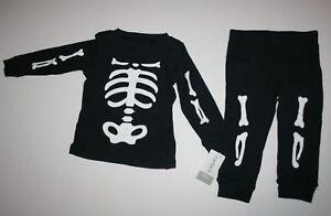 7e1ae7847 New Carter s 2 Piece Black Skelton Bones Pajamas Boys Size 12m NWT ...