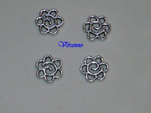 7738 fleur ± 15mm. 4 pendentifs entre-deux de métal