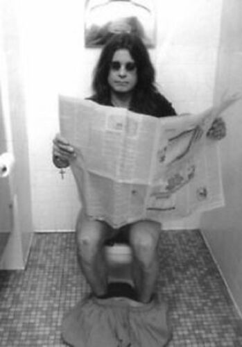 Ozzy Osbourne Reading Newspaper in the toilet  Poster  13x19 inches