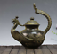 China-Old-bronze-The-shape-of-the-Phoenix-Carved-flower-Teapot thumbnail 1