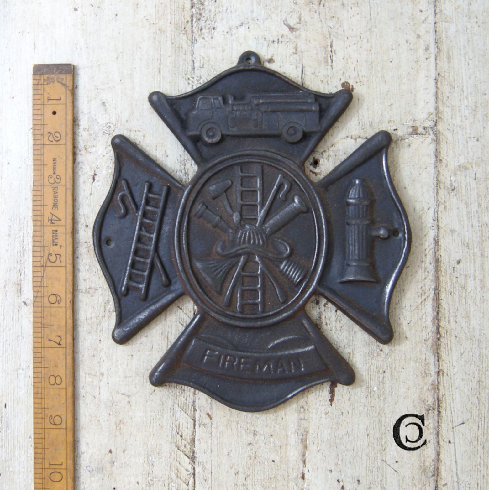 Cast Iron Fireman Emblems Plaque