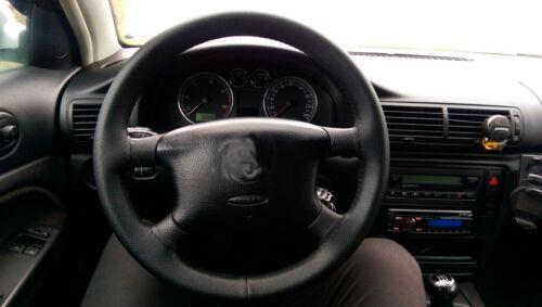 Funda de volante para Bmw E30 E46 Compact realizada en cuero liso o perforado