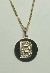 Curtis-J-Lewis-find-14k-yel-gold-B-diamond-disk-pendant-on-035-16-cable-chain