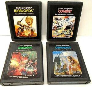 Lot of 4 Atari Game Cartridges Warlords, Combat, Berzerk, Defender
