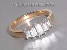 Diamond Ring: 0.64ct Emerald Cut 5-Stone Diamond and 18ct Gold Engagement Ring