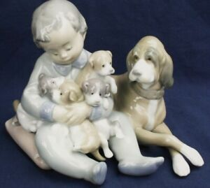 Lladro-NEW-PLAYMATES-Boy-with-Dog-amp-Puppies-model-5456
