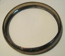 Very pretty gold tone metal bangle style bracelet with etched floral design