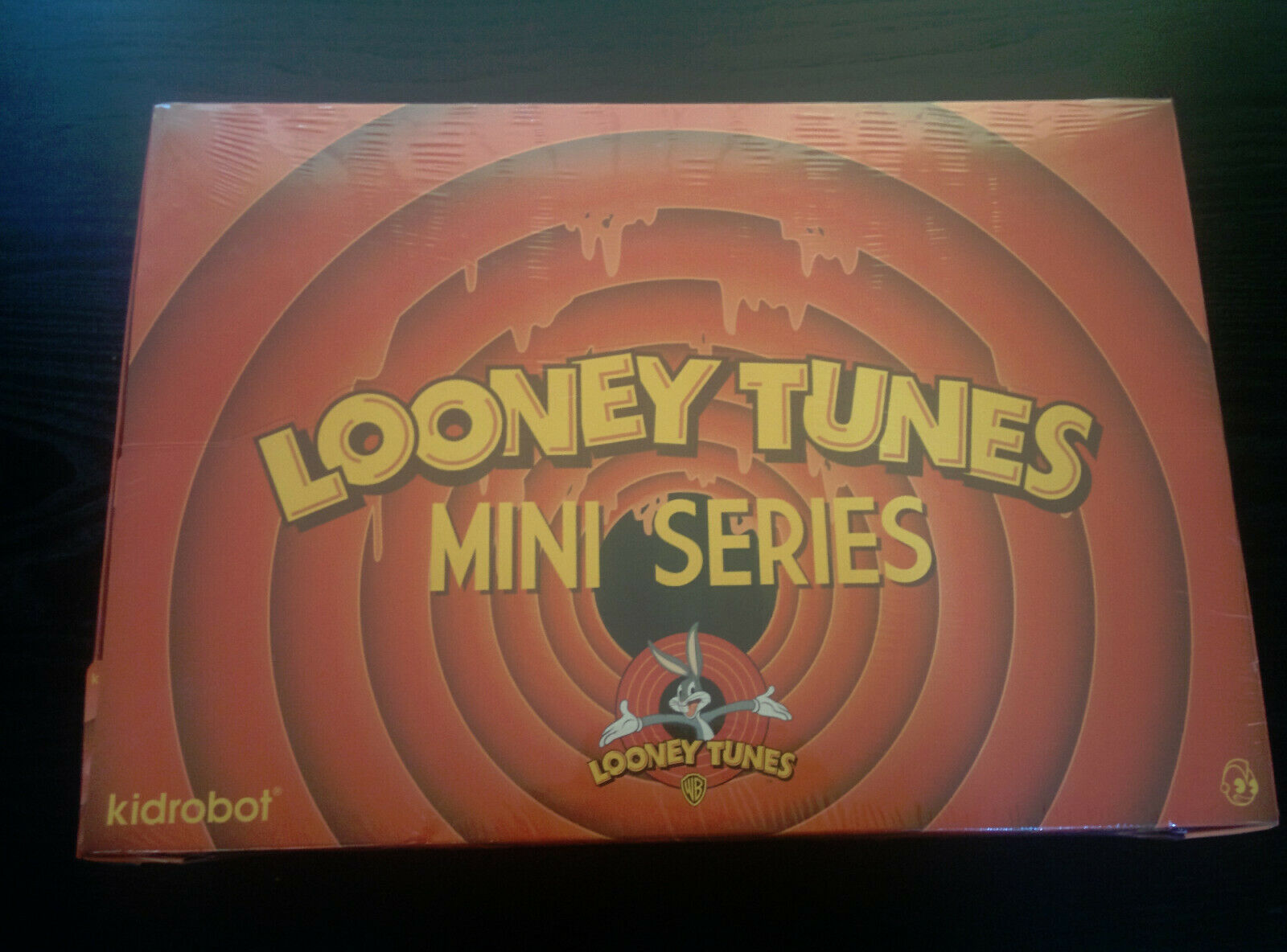 Kidrobot Looney Tunes case.  3  vinly figures.  Brand New.  20 blind boxes.