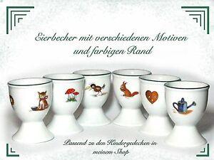 Eierbecher aus Porzellan mit grünem Rand und Motiven