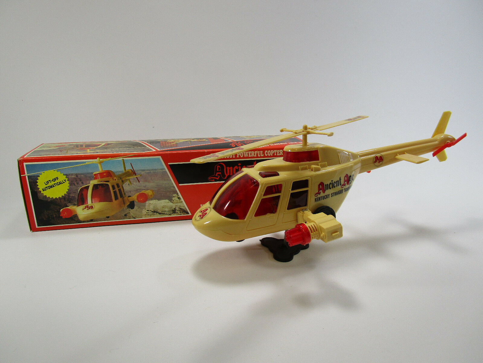 Vintage ancient age kentuky straight burbon adverdeising toy helicopter