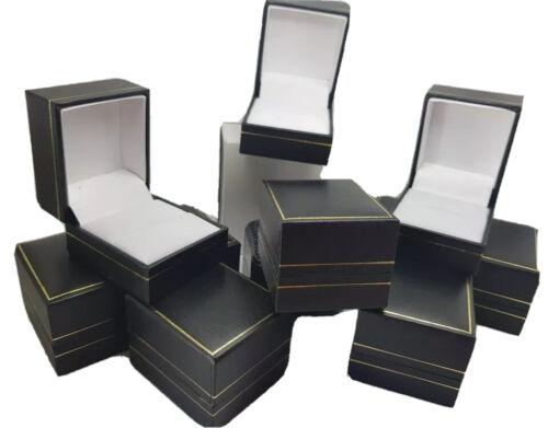 10 x leather black boxes white silk layout and white velvet ring cushion