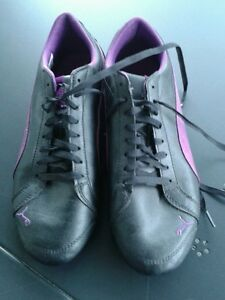Sneaker Sportschuhe Puma 40 schwarz mit Lila