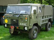 Photo. Green 1976 Land Rover 101 Forward Control at Automobile Show