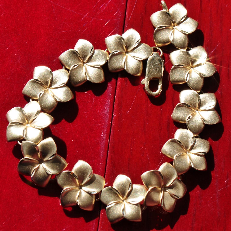 14k yellow gold bracelet 7.12  diamond cut flower link vintage 15.0gr  N2518A