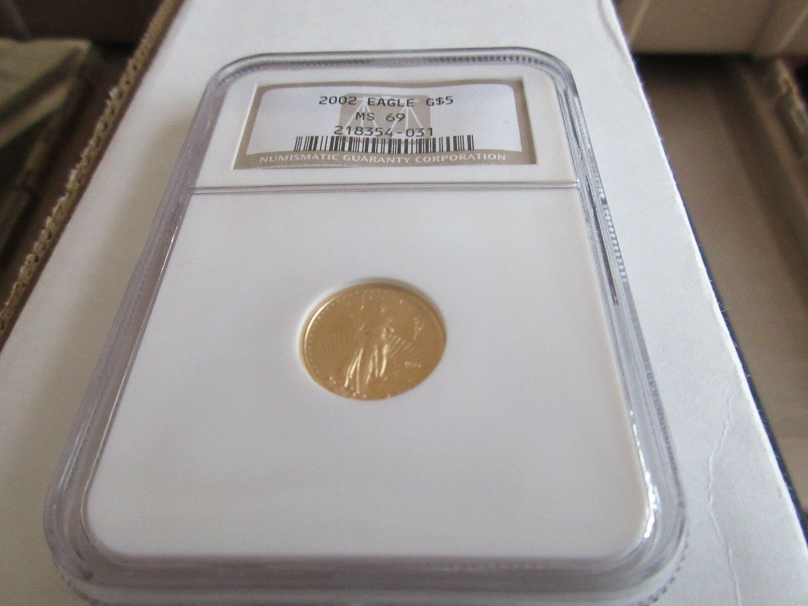 2002 , Eagle , G5$ , NGC , MS 69 , Tenth-Ounce Gold Ame