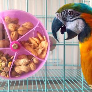 AM-EG-PET-BIRD-PARROT-CAGE-FEEDING-DEVICE-TOY-ROTATING-ROUND-WHEEL-FOOD-BOX-OP