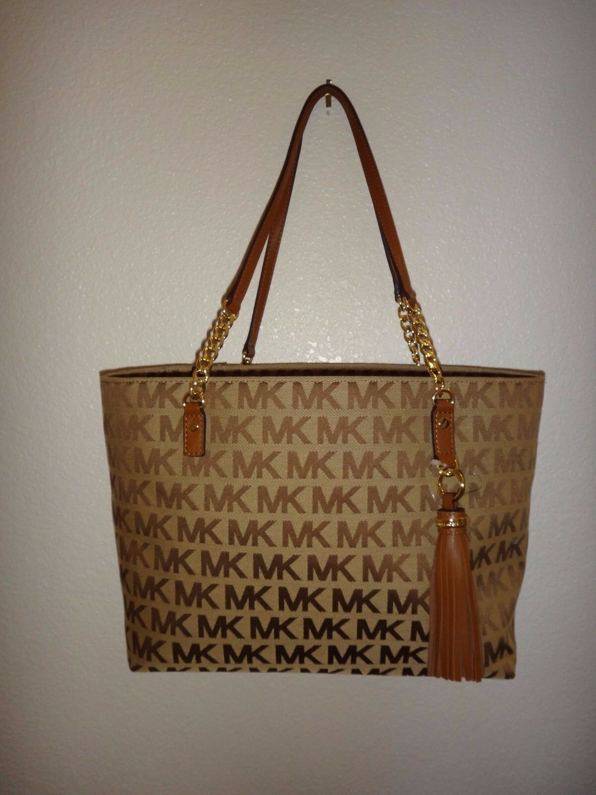845d3a08916a Michael Kors Jet Set EW Tassel Chain Tote Bag MK Signature Jacquard ...