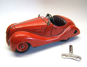 Tintoy-Blechspielzeug-Schuco-Akustico-2002-rot-D-R-P-Germany-Fahrt-Hupe-ok
