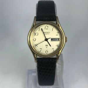 Vintage-Seiko-Womens-8523-0119-Gold-Dial-Black-Leather-Band-Day-Date-Watch