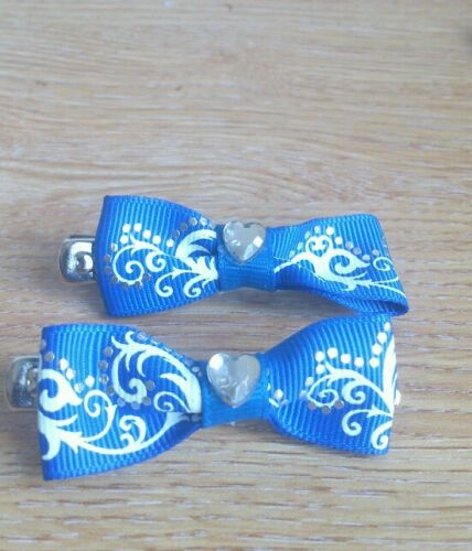 2 x Hand made blue swirl patterned bow hair clips