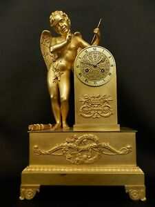 Antique-Gilt-Bronze-figural-mantel-Clock-with-winged-Angel-ca-1830